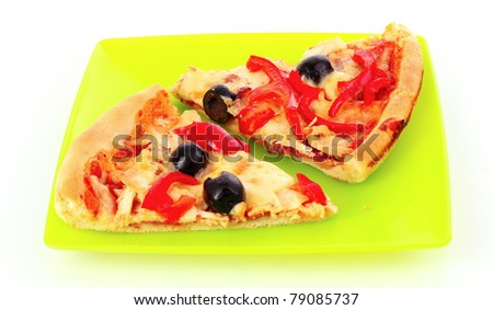 Pizza with olives and tomatoes closeup on green plate