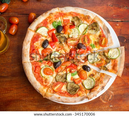 Pizza with peppers, olives and cheese - stock photo