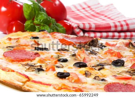 pizza with salami and vegetables - stock photo