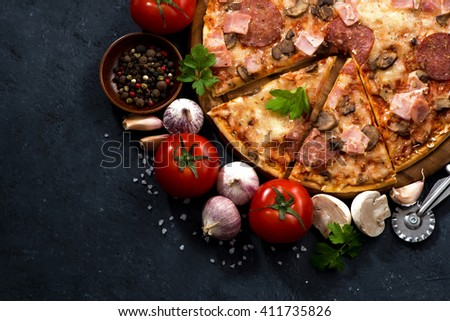 pizza with sausage and cheese and ingredients, top view, horizontal - stock photo