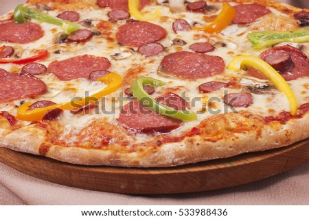 pizza with sausage and vegetables close-up with shallow depth of field