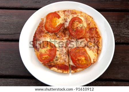 pizza with tomato slices in Cornwall - stock photo