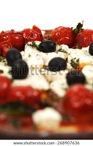 Pizza with tomatoes, black olives and goat cheese - stock photo