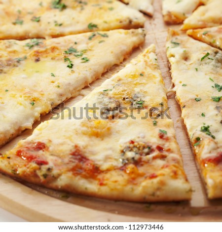 Pizza with Various Type of Cheese (Mozzarella, Roquefort, Feta and Processed Cheese) - stock photo