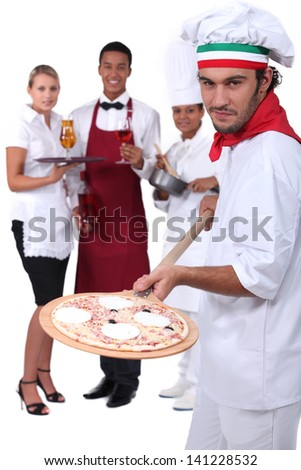 Pizzeria staff - stock photo