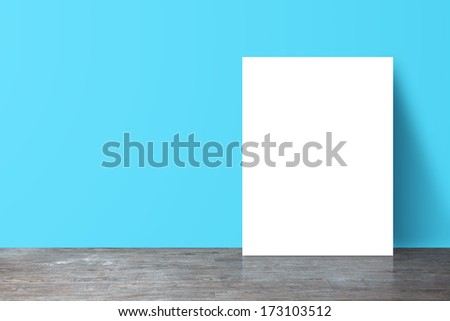 placard standing next to a blue wall - stock photo