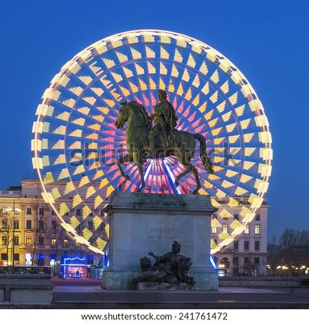 Place Bellecour statue of King Louis XIV, Lyon France  - stock photo