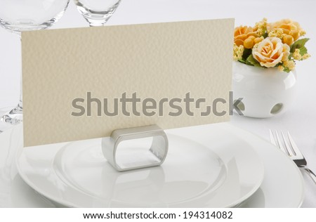 Place card on the white festive table - stock photo