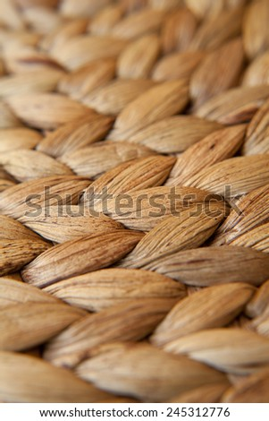 Place mat seen from macro perspective. Wattle mat. Place, wooden mat, use in a dining room on in a kitchen.