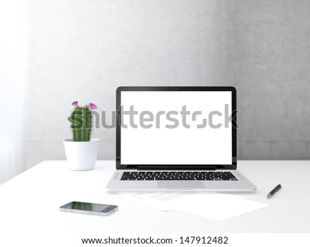 Place of work with electronic devices on desk next to the wall and window - stock photo
