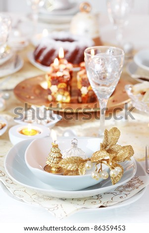 Place setting for Christmas in golden and white tone - stock photo