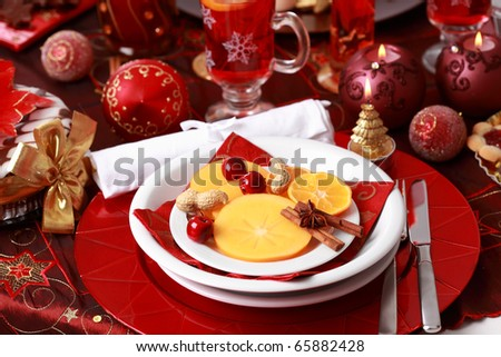 Place setting for Christmas with fresh fruits - stock photo