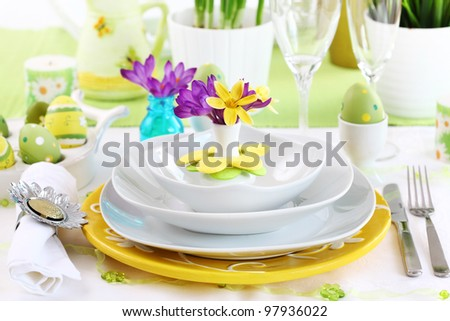 Place setting for Easter with crocuses - stock photo