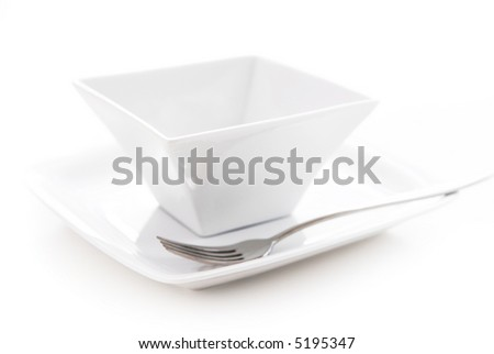 Place setting of white plate and bowl isolated on white background - stock photo