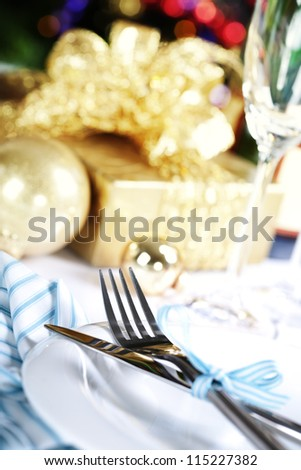 place setting on Christmas tree background - stock photo