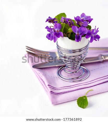 Place Setting whit Viola Flowers - stock photo