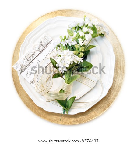 place setting with invitation and flowers - isolated on white