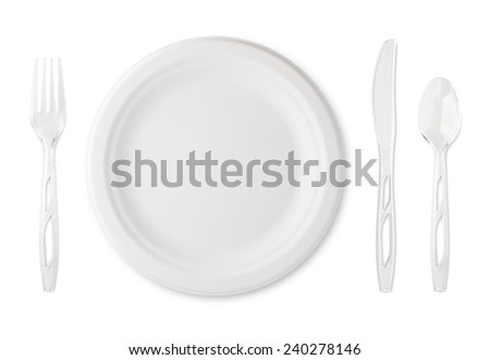 Place setting with paper plate and clear plastic utensils. The subject is isolated on white and includes a clipping path. - stock photo