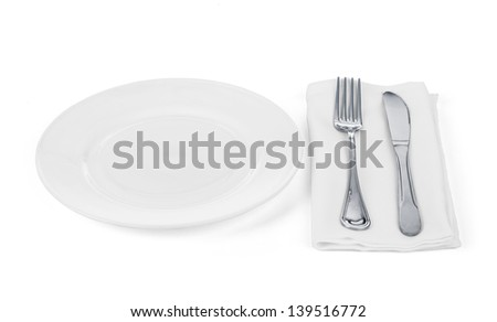 Place setting with plate, knife and fork,on white - stock photo