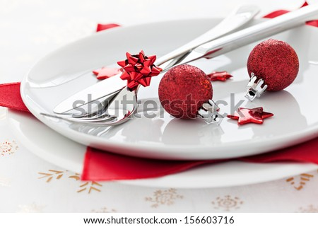 place setting with red baubles  - stock photo