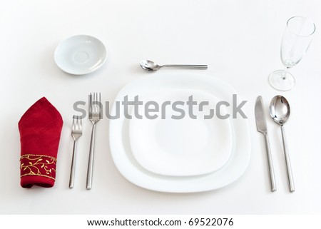 place setting with white dishes - stock photo