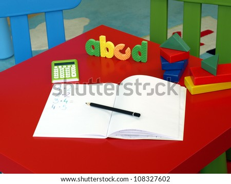Place with exercise book for child to work - stock photo