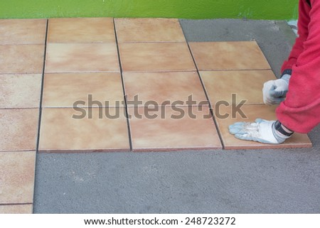 placement of stoneware tiles on cement mortar - stock photo