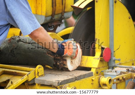 Placing a log on machinery