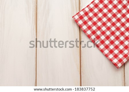 Plaid cloth on picnic table/Picnic table background - stock photo