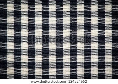 Plaid cotton fabric texture background.