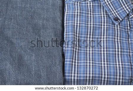 Plaid shirt and denim jeans - stock photo
