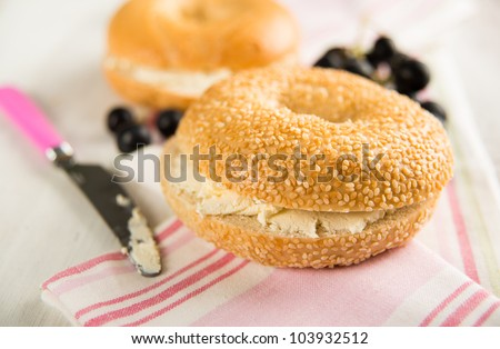 Plain ans Sesame Seed Bagels with Cream Cheese and Grapes - stock photo