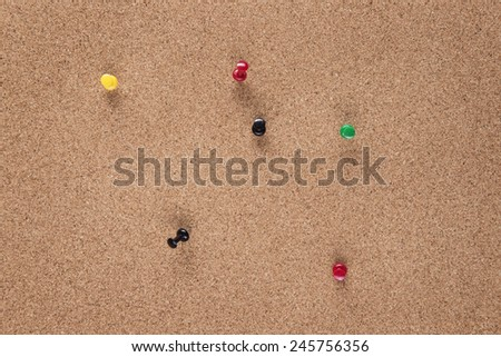 plain cork pin board with pins in it  - stock photo