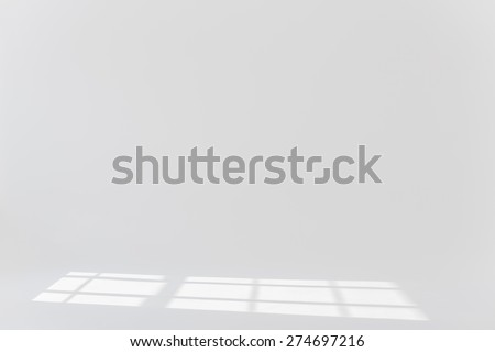 Plain white background with sun light and shadows