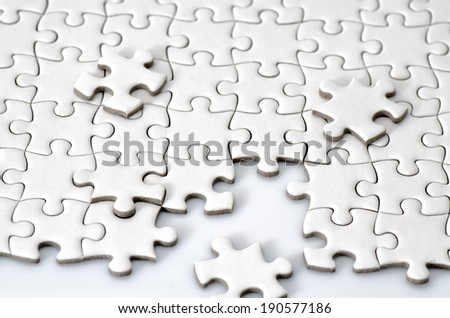 Plain white jigsaw puzzle. (isolated on white background.)