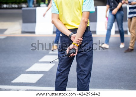 Plainclothes Police, Officer, Security guard watching people walking at street. - stock photo