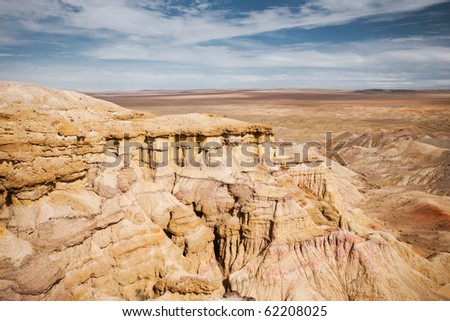 Plains of the flaming cliffs of Bayanzag, a region in the Gobi desert of Mongolia famous for discoveries of dinosaur eggs and fossils. - stock photo
