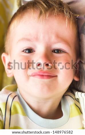 Plaintive portrait of cute little boy - stock photo