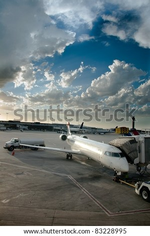 Plane Boarding - Airplane in tarmac ready to be boarded by flying passengers and crew