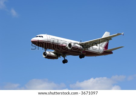 Plane flying in the air. - stock photo
