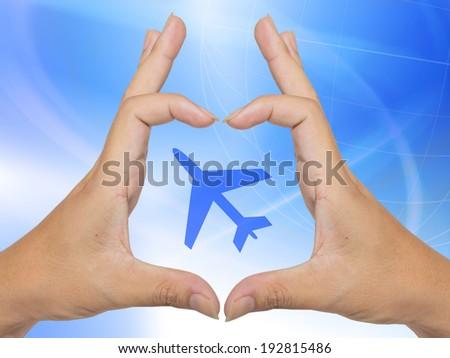 Plane icon on hand - stock photo