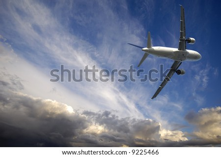 Plane is escaping from bad weather - stock photo