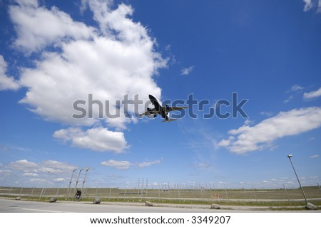 Plane is going to land. Blue and cloudy sky. - stock photo