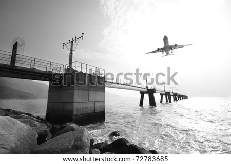 Plane is going to land in an airport. The plane is a bit in motion blur because of the speed. - stock photo