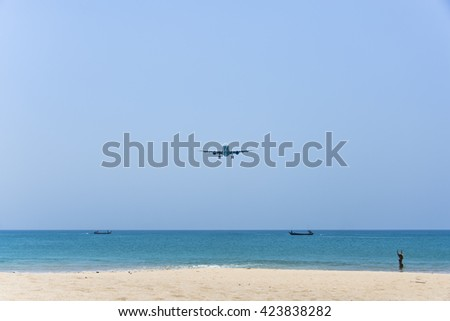 Plane is landing over the beach - stock photo