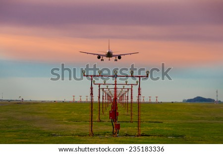 Plane landing in the airport at sunset ( sunrise ). Night flight. Vancouver. Canada - stock photo
