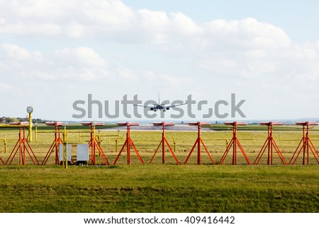 Plane landing on runway - stock photo