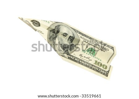 plane of the money on a white background. (isolated) - stock photo