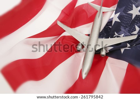 Plane on American Flag - stock photo