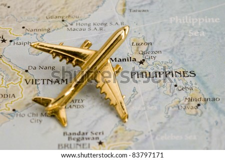 Plane Over Phillipines, Map is Copyright Free Off a Government Website - Nationalatlas.gov - stock photo